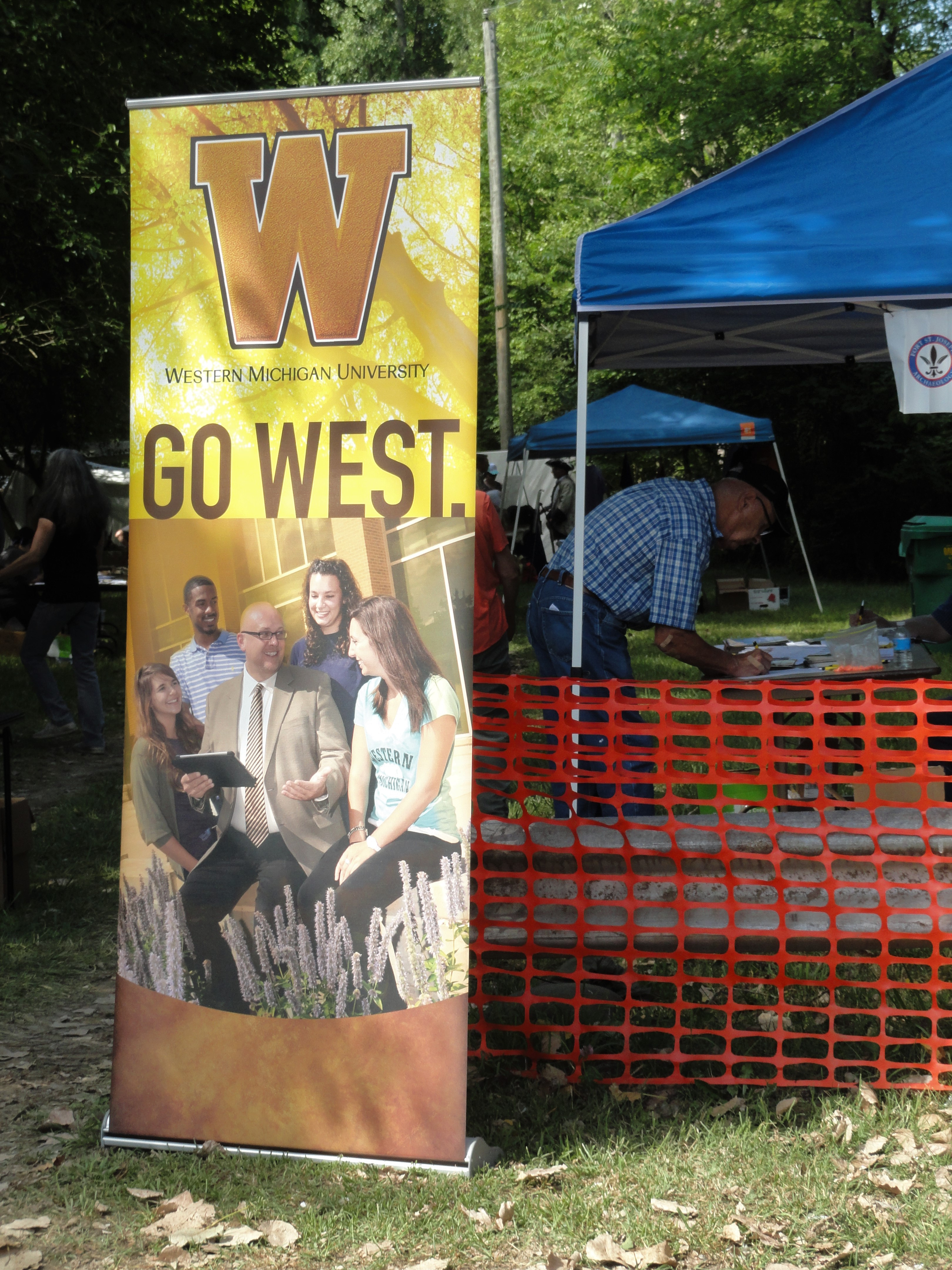 "Entrance of Fort St. Joseph open house. Advertisement for Western Michigan University encourages people to ""Go West."""
