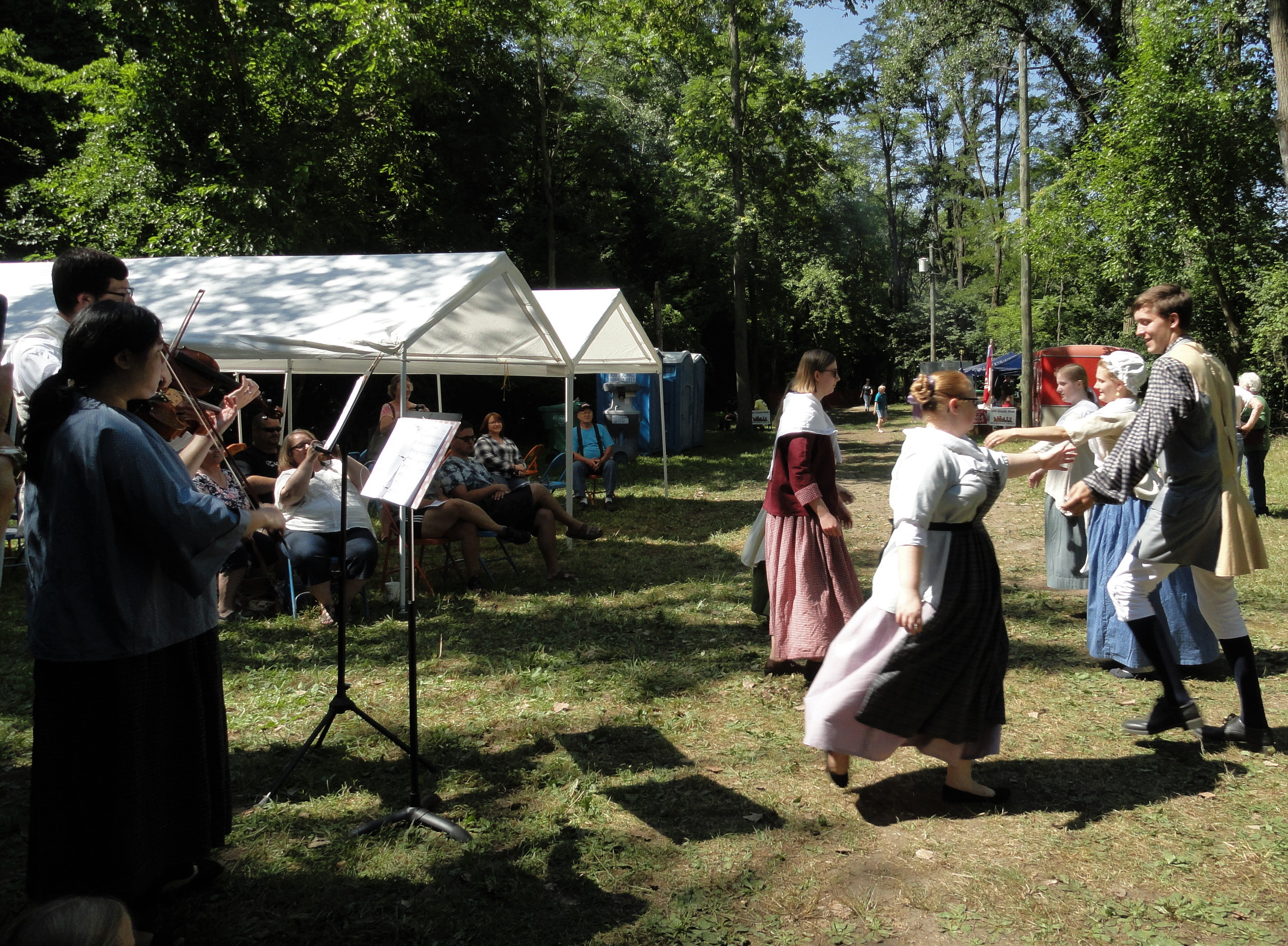 Living history demonstrators play music inhabitants of Fort St. Joseph might have listened to and demonstrate a popular dance of the period.